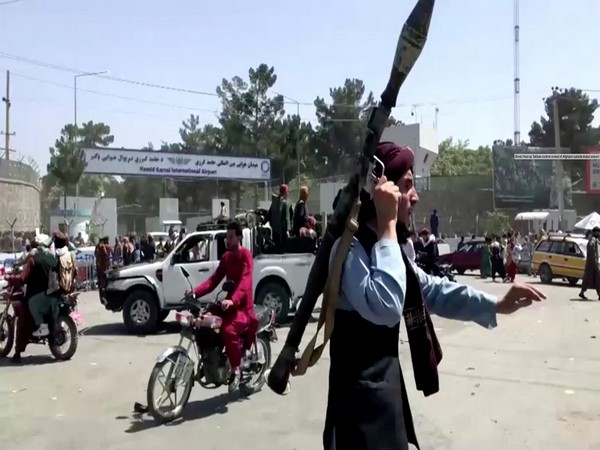 Desperate Afghan women throw babies over razor wire at Kabul airport compound