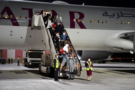 Qatar flight with more than 230 evacuees leaves Kabul, official says
