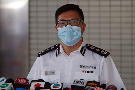 Hong Kong security chief steps up pressure on city's main press group