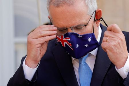 Australian PM departs for Quad meeting amid French submarine deal fallout